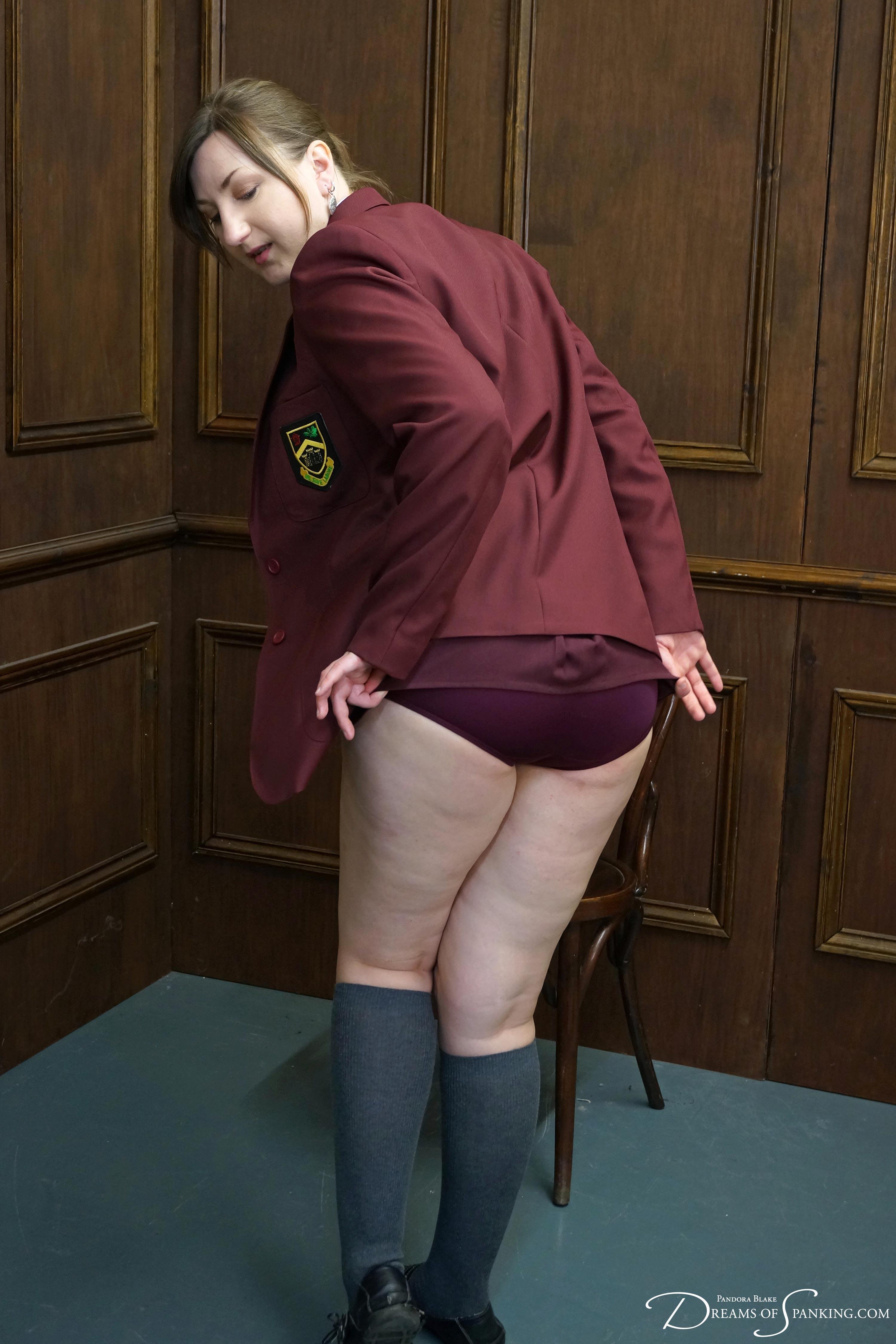 Spank over skirts