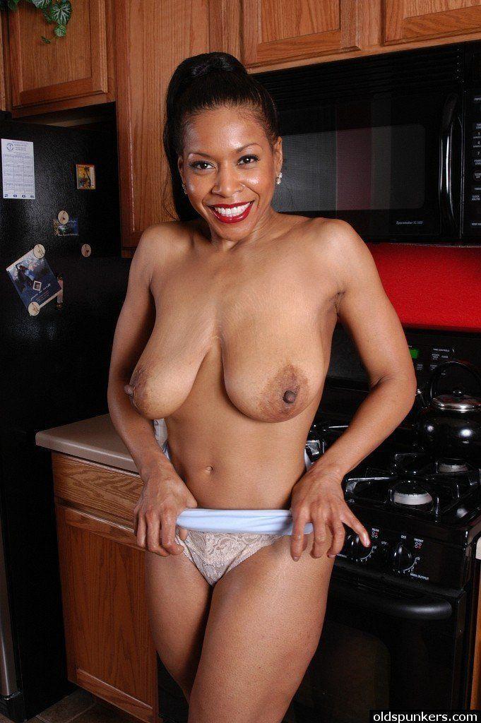 Black matures undressing